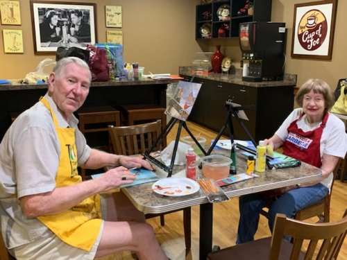 Harold and Kay creating a masterpieces in art class!