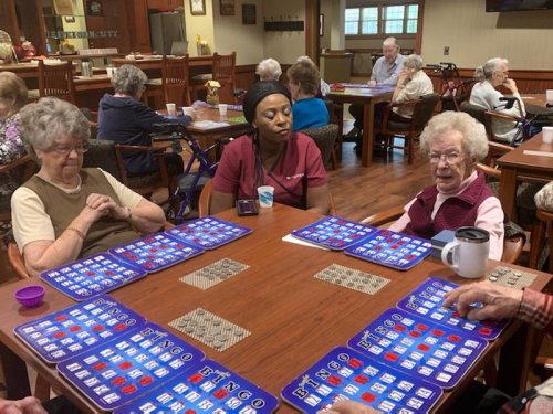 Dorothy decided to take a minute to spend some time with residents during bingo.