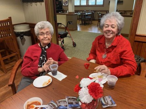 Jenetia and Sandy wear red to support the KC Chiefs as they play in the Super Bowl
