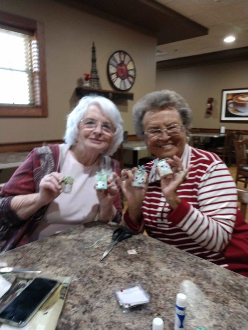 Sharon and Mary are showing off their gift boxes they made in their craft activity.