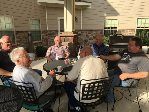 The men of Primrose Jefferson City are enjoying a coffee social with Doug, maintenance