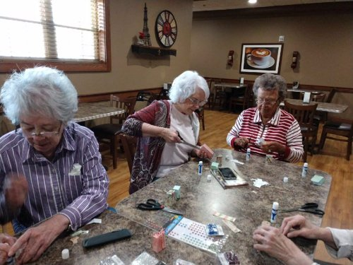 The ladies are working hard during their craft activity.