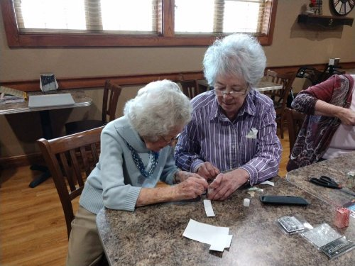 Sandy is assisting Jessie while making gift boxes in their craft activity.