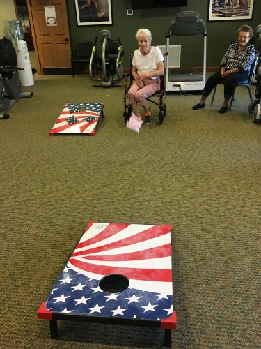 Bev is trying hard to win the bean bag toss