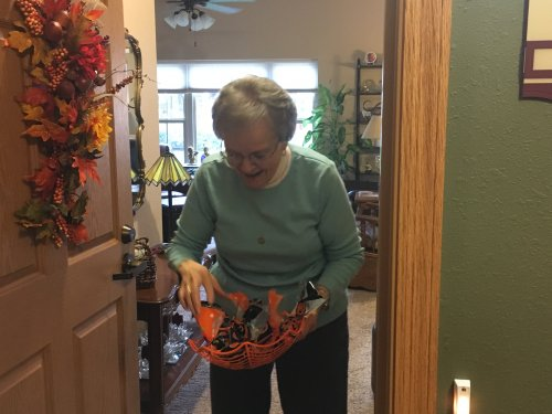 Shirley loves handing out candy to the trick or treaters.