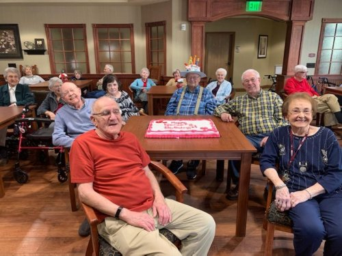 Residents celebrating at our monthly birthday party.