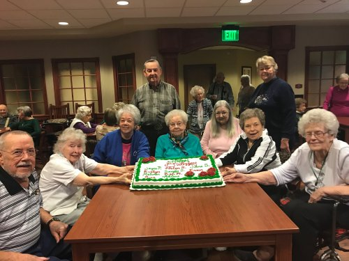 These residents all have December birthdays and they are celebrating at the monthly birthday party!