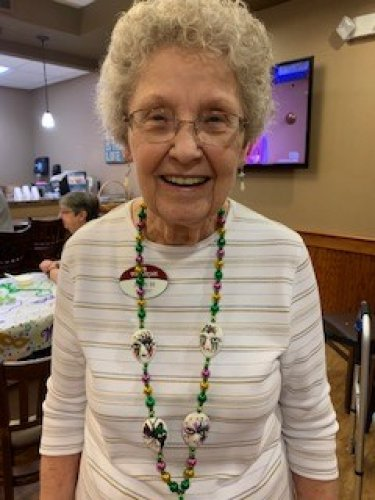 Joan enjoyed wearing her beads for the Mardi Gras ice cream party!