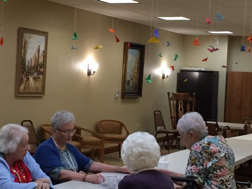 100 Origami butterflies hang from our Hobby Room in celebration of Lillian's 100th Birthday.  Sadly she wasn't well enough to enjoy them in person.