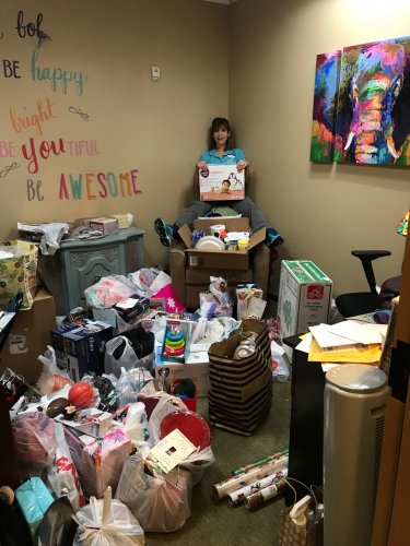 Cindy is with all of the gifts in the Life Enrichment Office.  We adopted 2 families and our amazing residents filled every wish plus we donated a Walmart gift card to each family!
