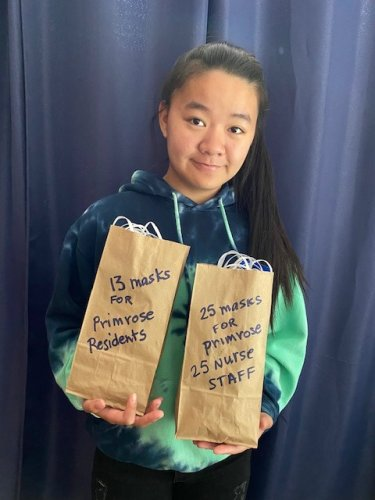 """🧵Bo Evans, age 14,  is working on earning her Girl Scout Silver Award (next is Gold Award).  Before her sewing corona fabric masks project,  Bo had never used a sewing machine.   Bo handmade each mask by herself.  For weeks, in addition to going to school (8 grade), Bo measured out the fabric 7""""X  9"""",  cut out the fabric, pinned the fabric/elastic, sewed the fabric, and ironed each mask.  She handmade a total of 60 fabric masks.   On 4 May 2020 Bo donated to the Primrose Senior Community nursing staff 25 masks and 13 masks to the residents."""