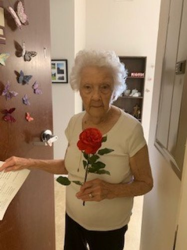 One of the local flower shops had to close their business during the virus outbreak so they sent their flowers for us to give out!  Martha was thrilled to get such a beautiful rose.