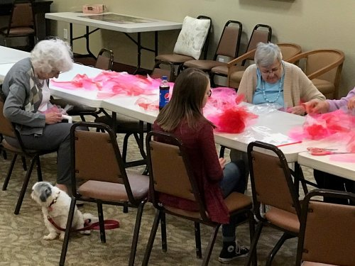 Even our residents dogs love doing the craft with our ladies here in KC.