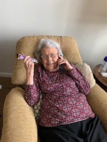 Martha kicked back in her recliner, talking on the phone and was super happy we brought ice cream to her room!