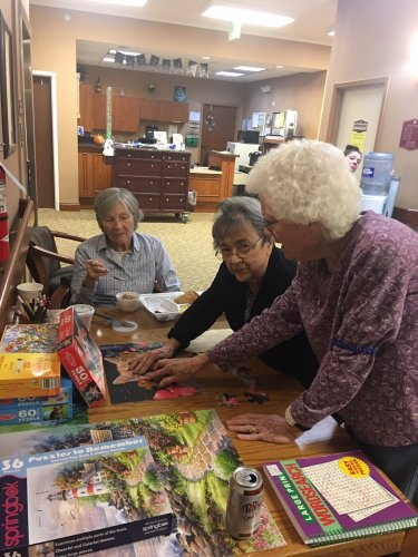 Our assisted living residents working hard at getting the puzzles together@