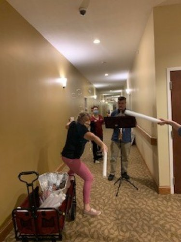 Our LEC Jill has a light saber fight with our resident Maria E. while Jim our PMT plays the Star Wars Theme on the Sax 'May the 4th be with you!'