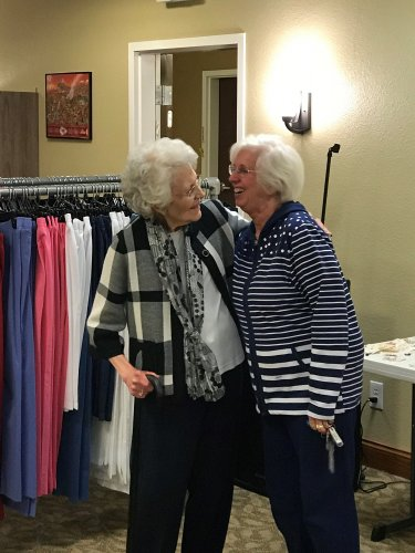 Carole and Lin having a good laugh while shopping here at Primrose!