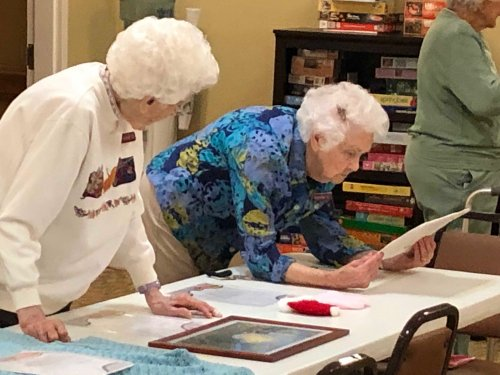 Martha & Rosemarie looking over all the item our residents our set out for us to admire!