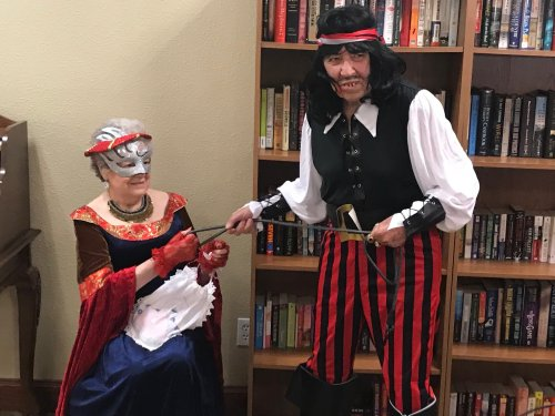 John & Marie C. won best costume!  The rich woman being taken way by the pirate.