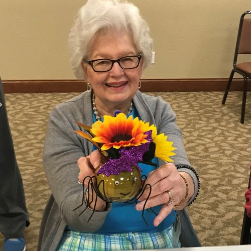 Betty C. showing off her spider she made at craft time here at PrimroseKC