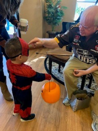 Bob is giving Spider man some candy
