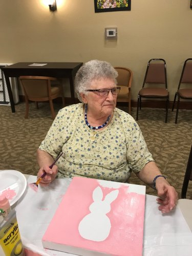 Darlene painting a cute bunny for Easter