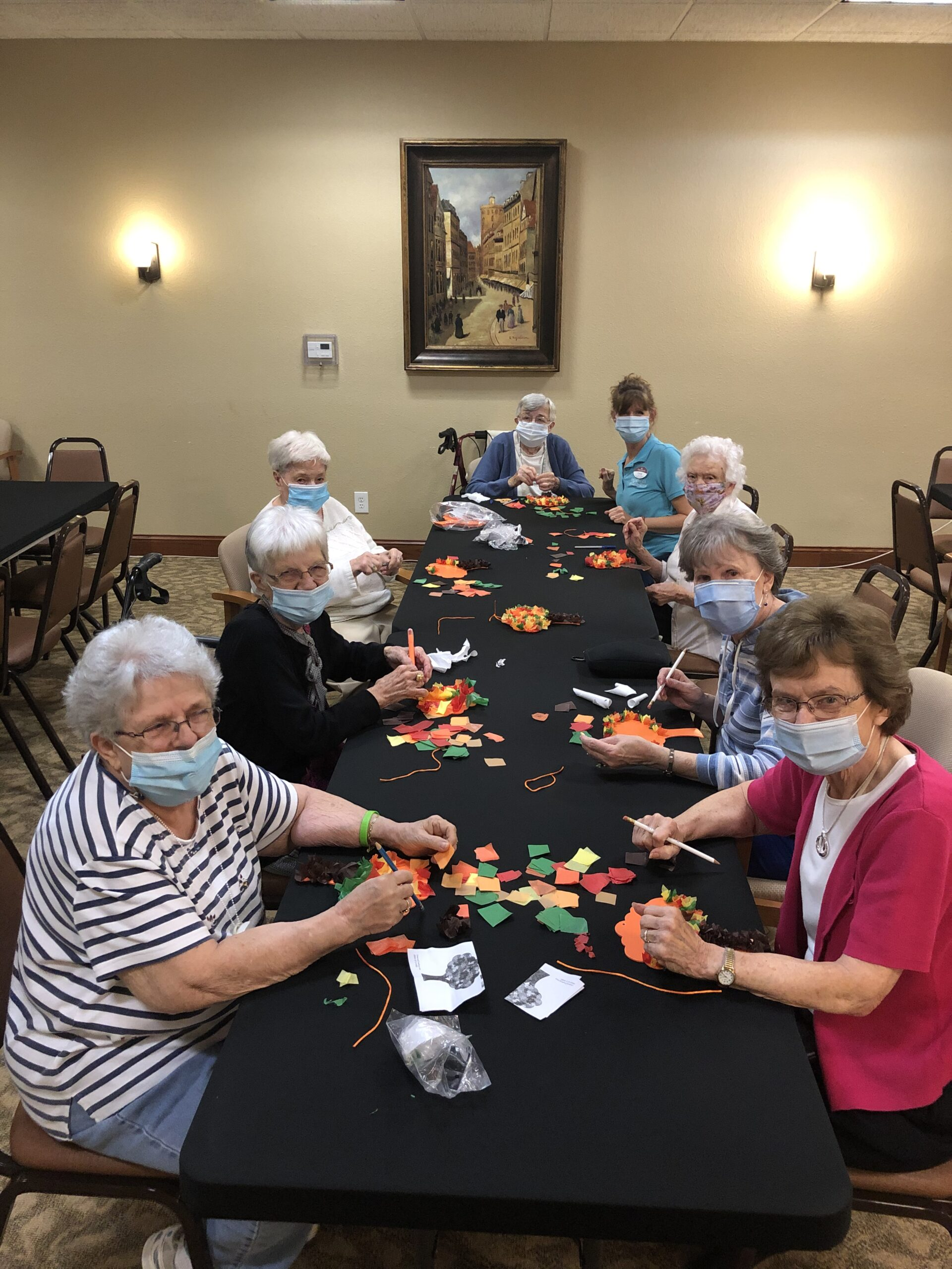 Residents making our fall tree craft!