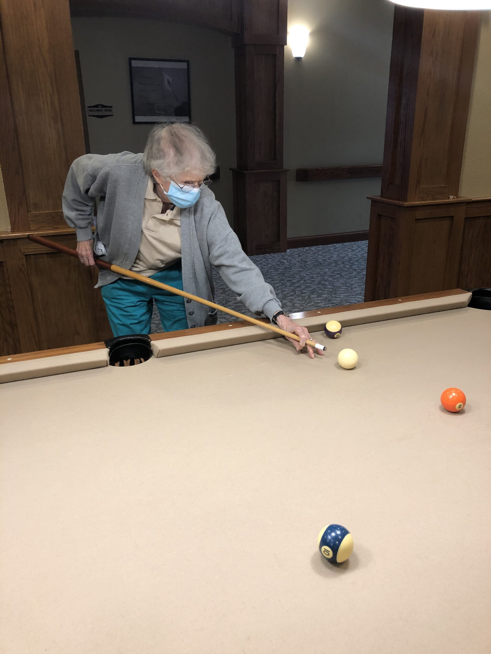 Mary Jo learning to play billiards.