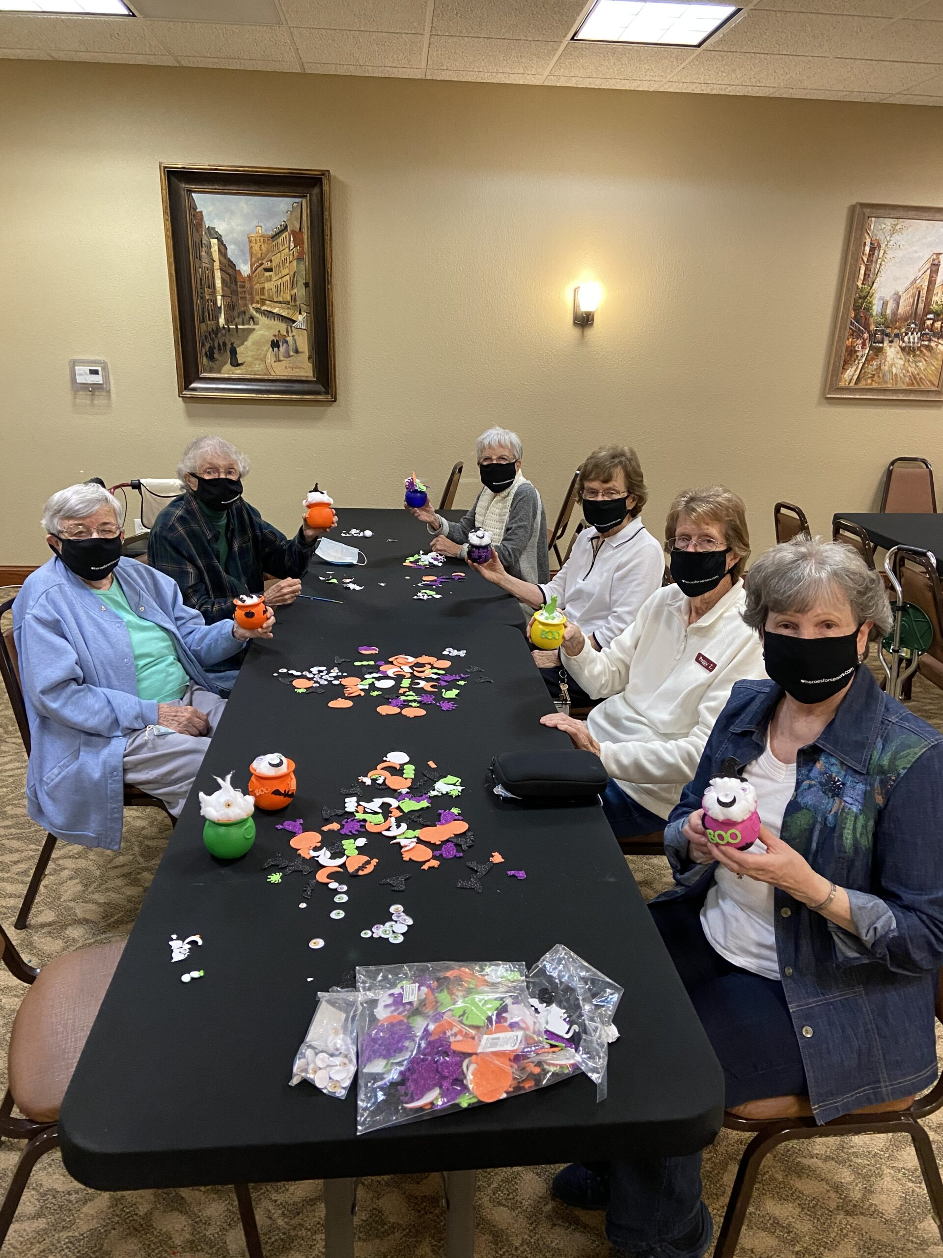 Residents participating in the Halloween craft.