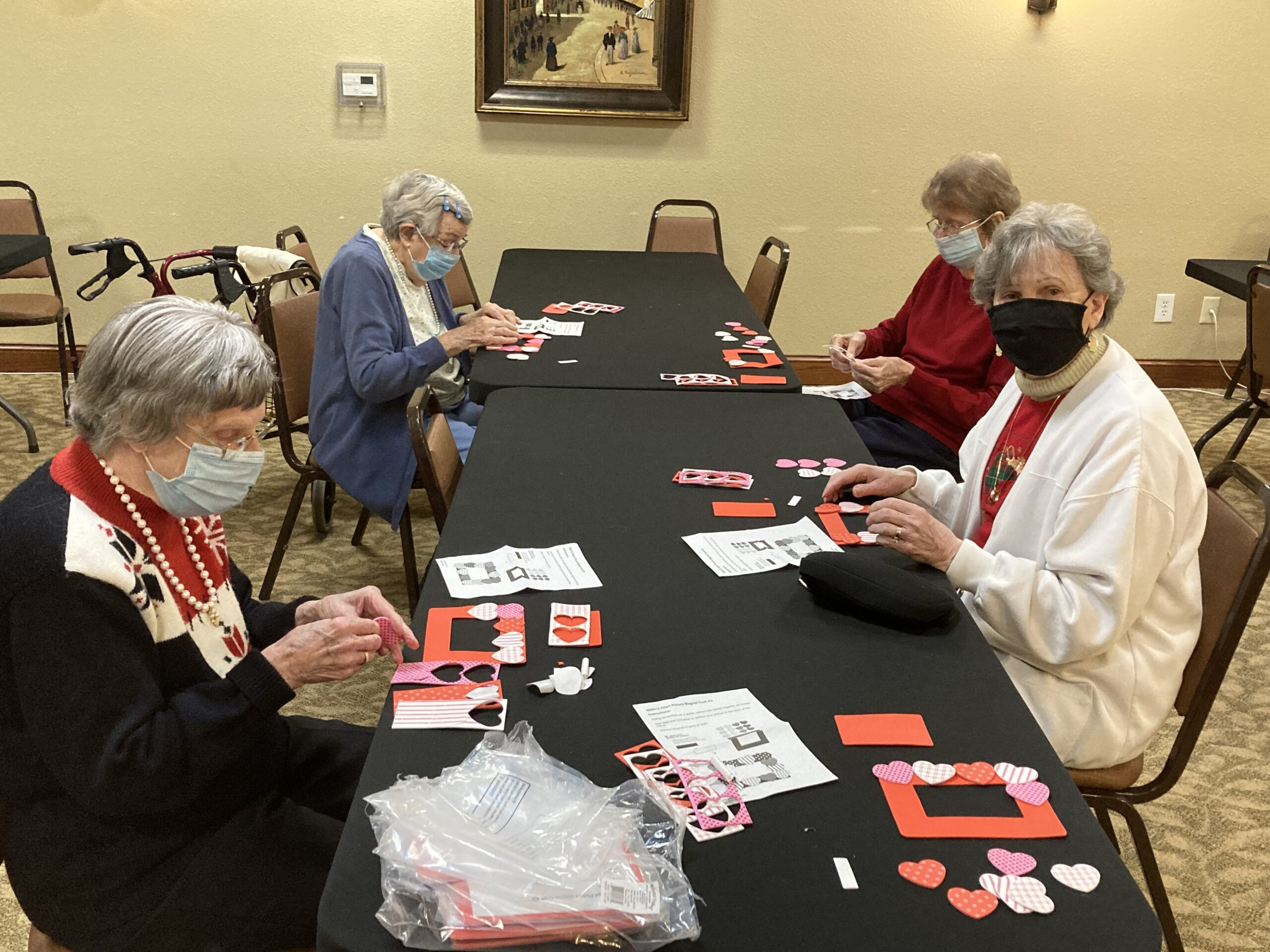 Residents working hard on their Valentine's Day picture frames