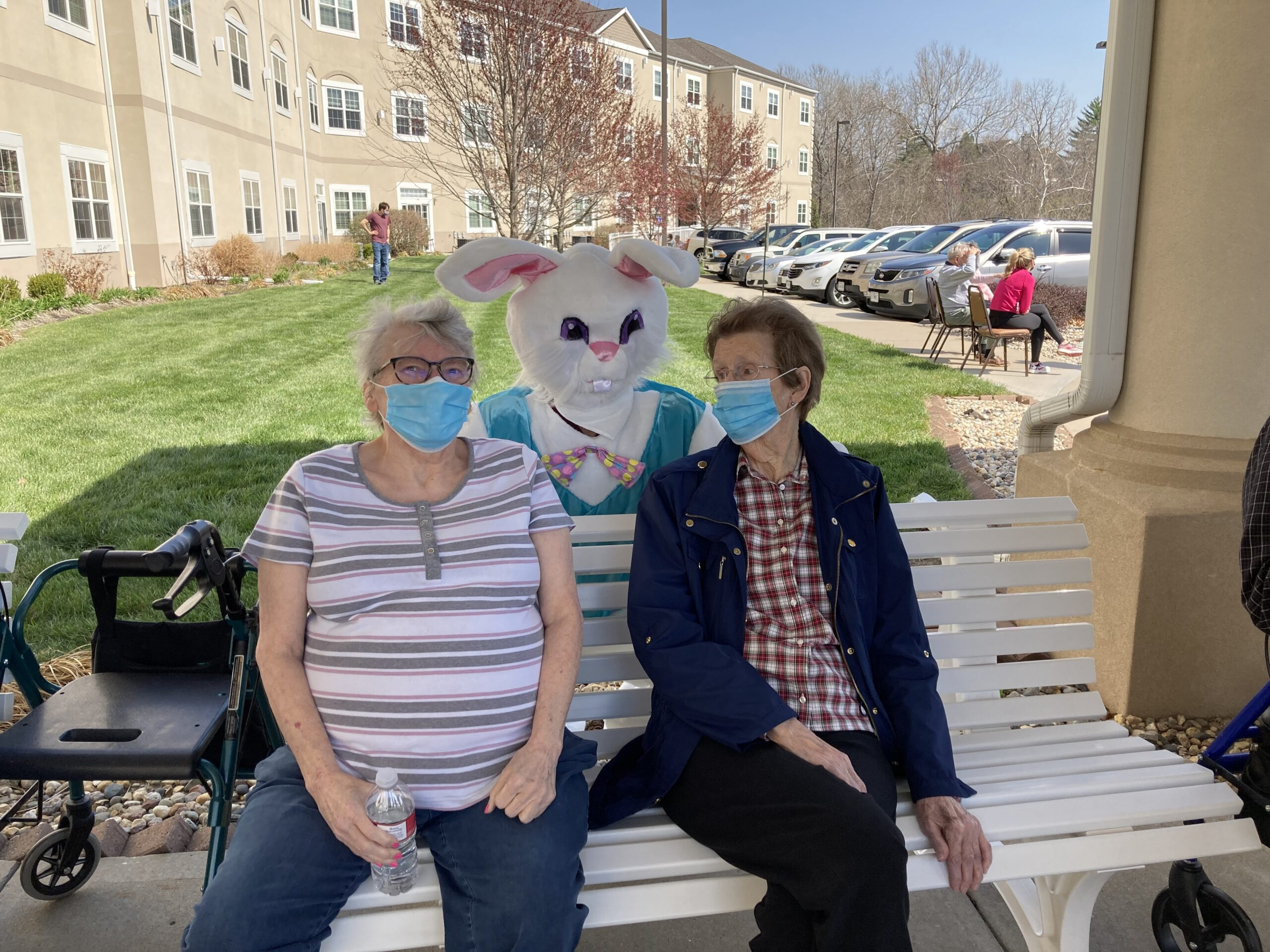 Cheryl and Peggy smile with the Easter Bunny