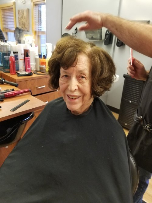 Miss Kate getting her hair done and always smiling