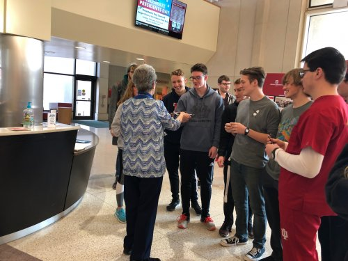 Jeanne passing out gifts to some students at IU Kokomo