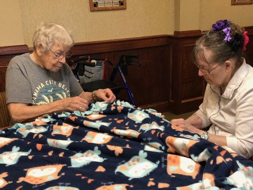 Making blankets for the woman's shelter