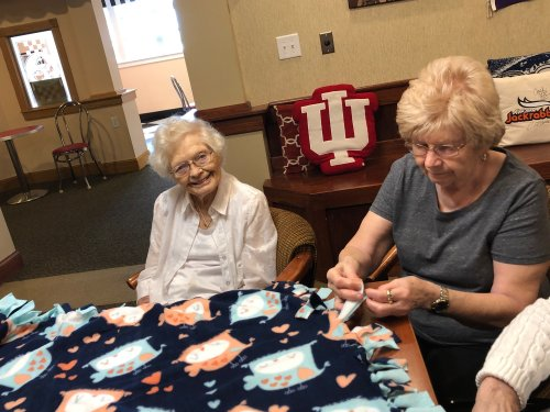 Having fun tying blankets for the woman's shelter