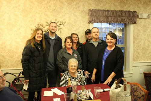 Corina and her family getting ready to enjoy a Thanksgiving dinner