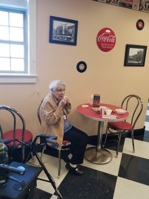 Gail is finishing up her ice cream.