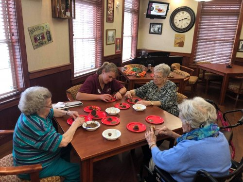 Legacy and Resident making Turkey cookies.  Nothing is better than making and eating cookies