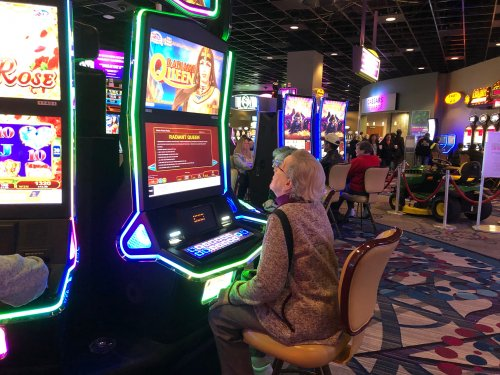 Sue playing the slots at Anderson