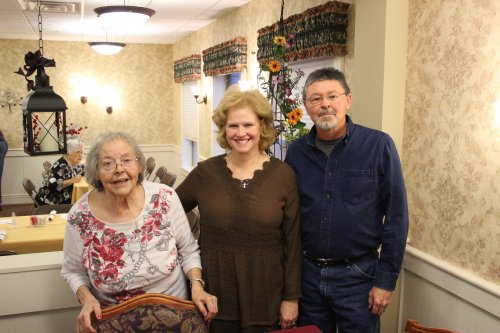 Phyllis and family enjoying a Thanksgiving dinner together.