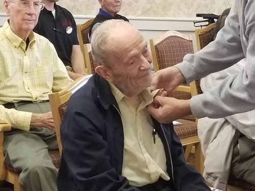 Bob being pinned for his service in the Navy