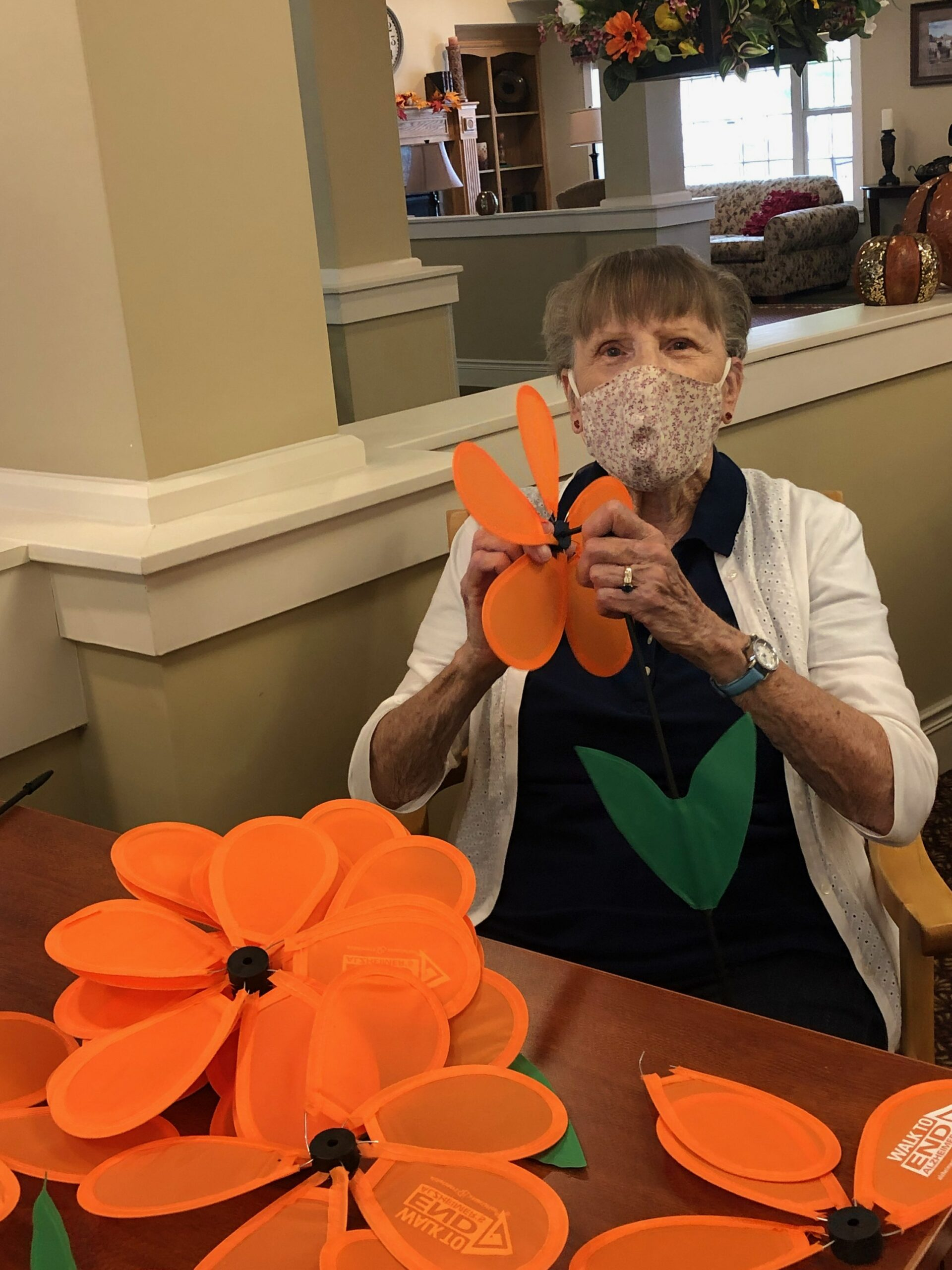 Pat loves to help and had a lot of fun putting together the Alzheimer's flowers for our walk next week