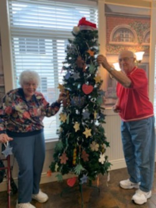Shirley & Jerry members of the Helping Hands Committee, are putting the ornaments on tree. Kicking off our Adopt a Family program for Christmas.