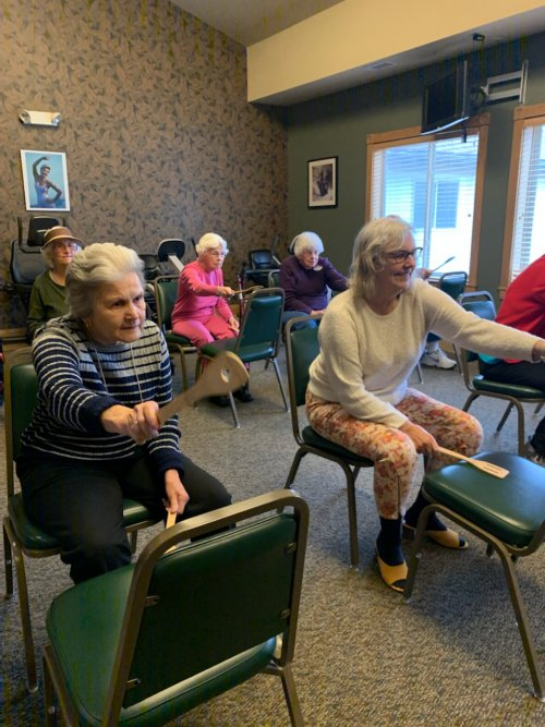 Marlene and Jane are giving the Drumming Exercise class a whirl for the first time.