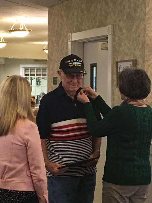Jerry receiving his pin during the Veteran's Pinning Ceremony.