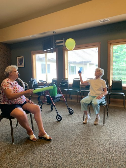 Mary and Norma are doing their best to keep the balloon in the air during a afternoon of Noodle Ball.