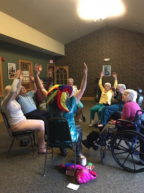 A group of residents participating in Laughter Yoga class.