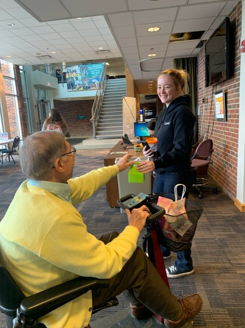 Ambassador Bob Handing out a goody bag for Random Acts of Kindness Day.