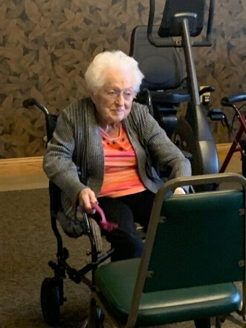 Marjorie is getting a workout during an afternoon drumming exercise class.