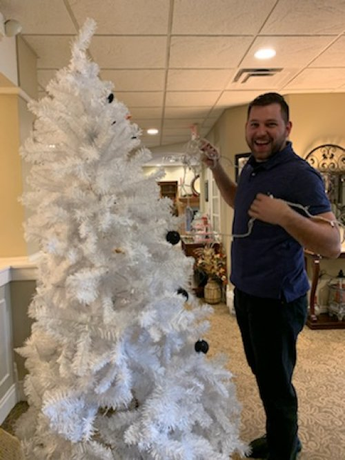 Brandon is giving a hand with the Snowman Tree.